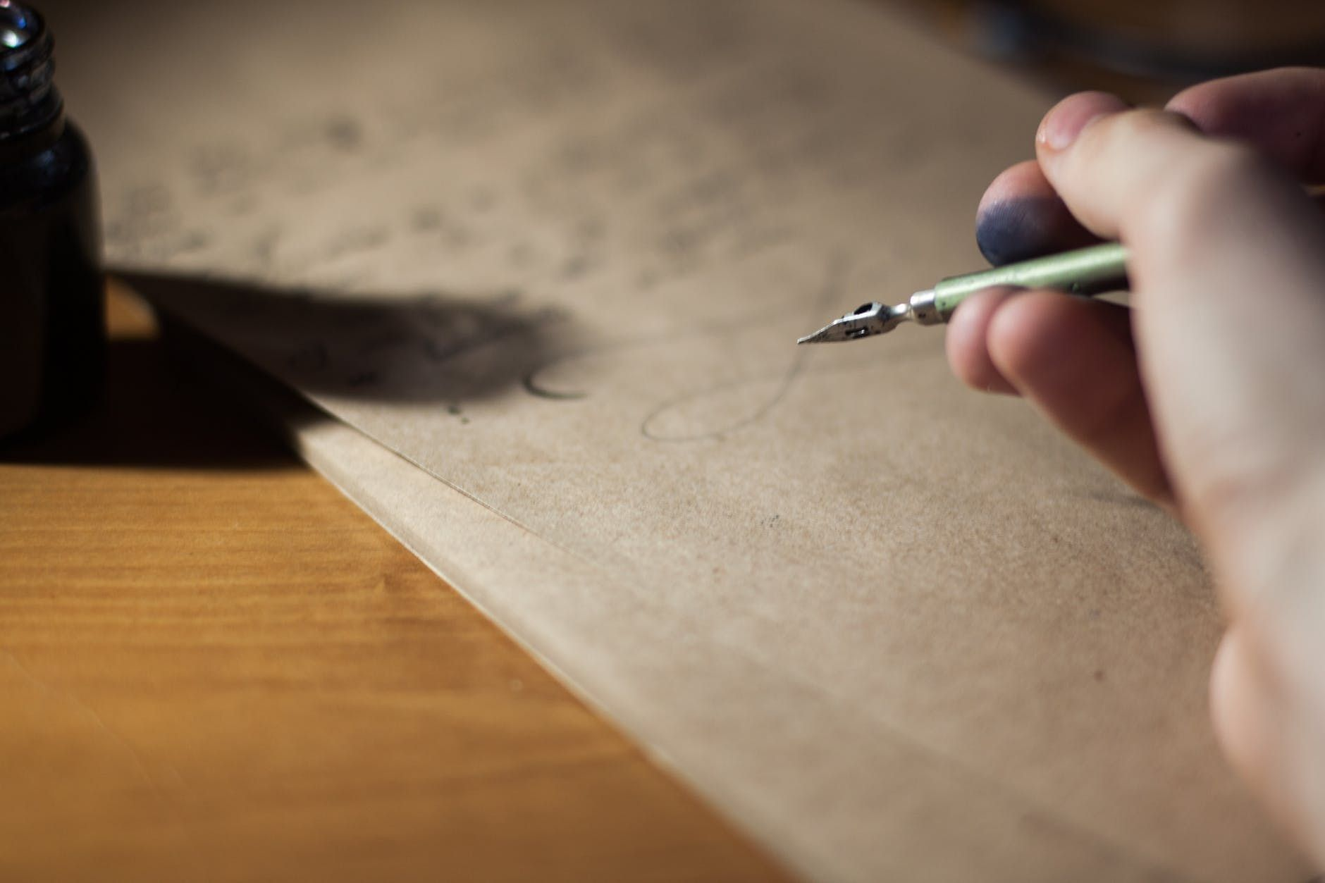 Writing a letter with an ink pen