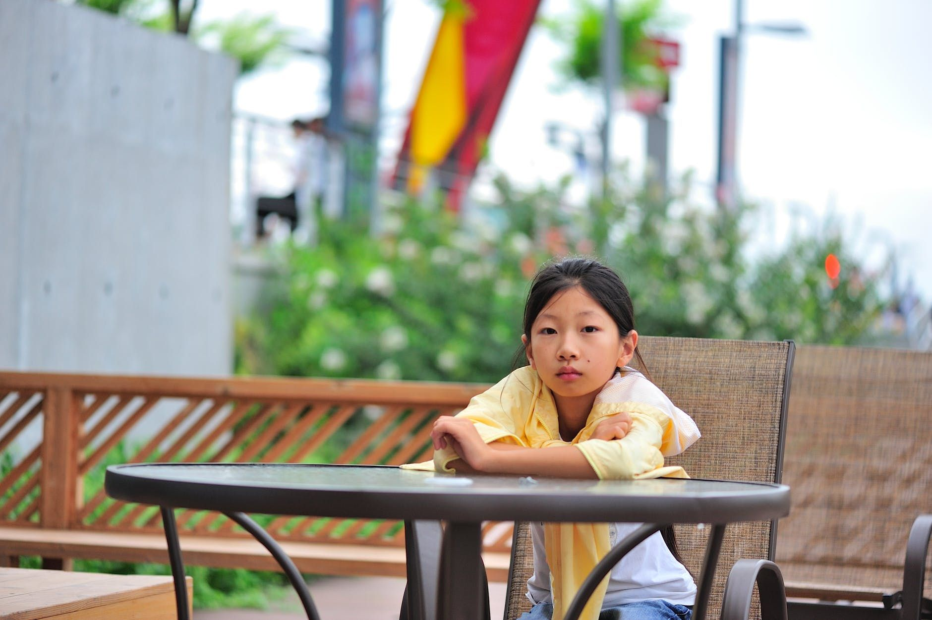 A Chinese school student sitting a table outside
