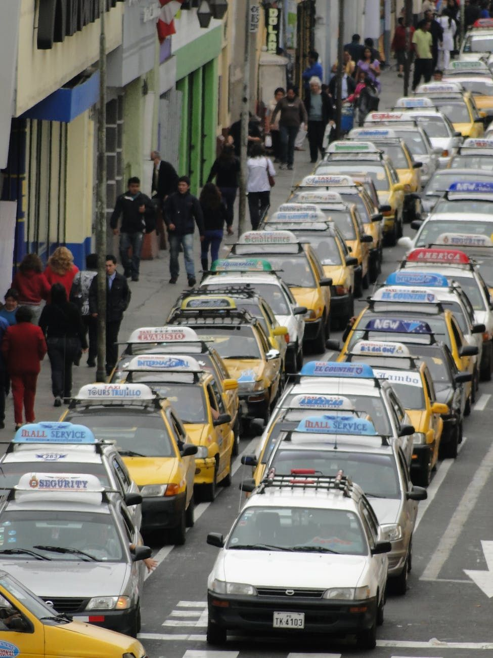 A traffic jam taking place in a busy city