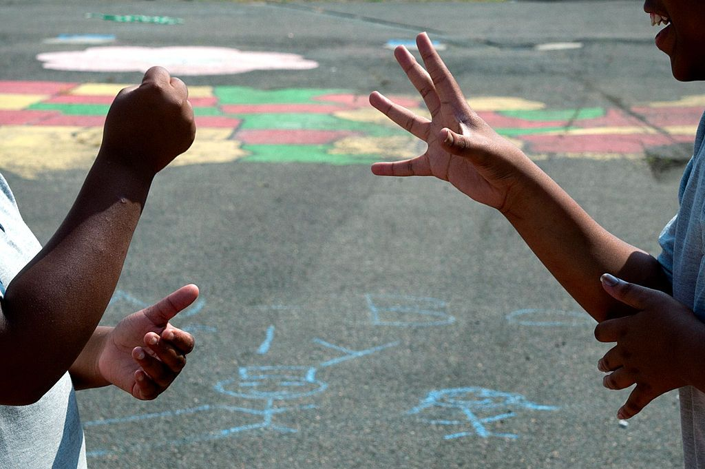 A game of Rock Paper Scissors in the playground