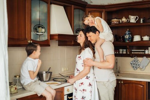 A family having fun together in the kitchen