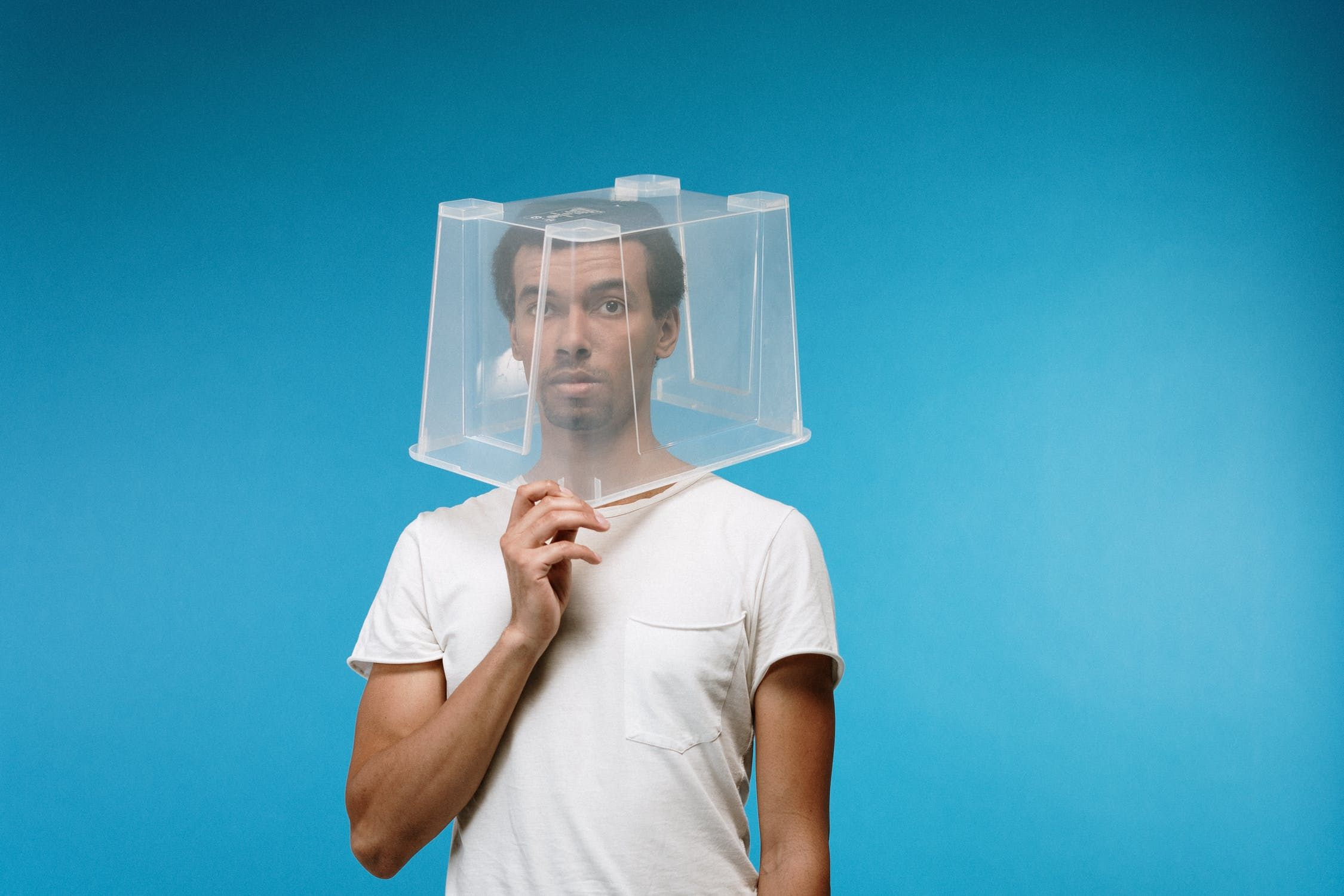 A man with a plastic box on his head