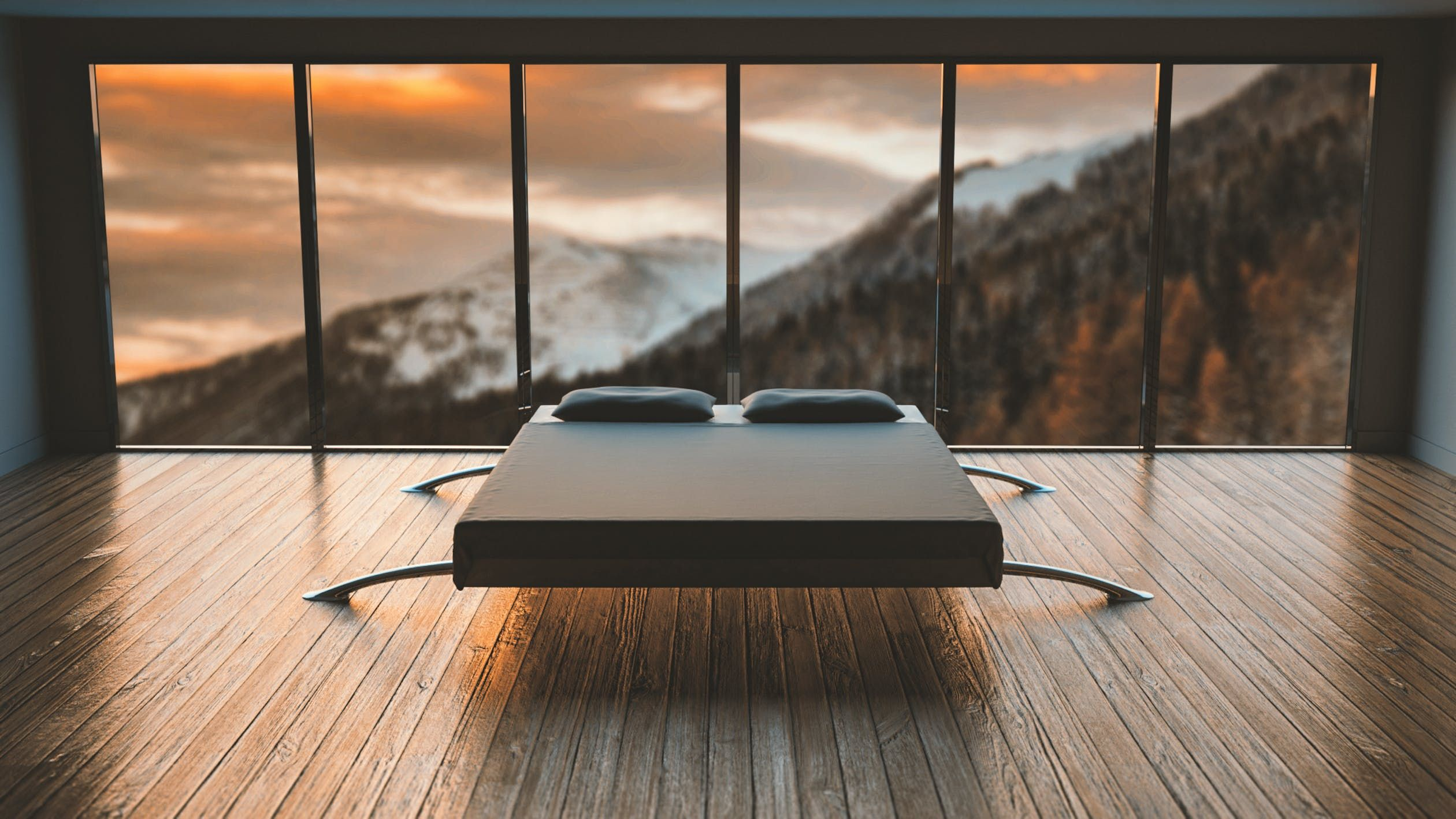 A black mattress facing a mountain sunset view