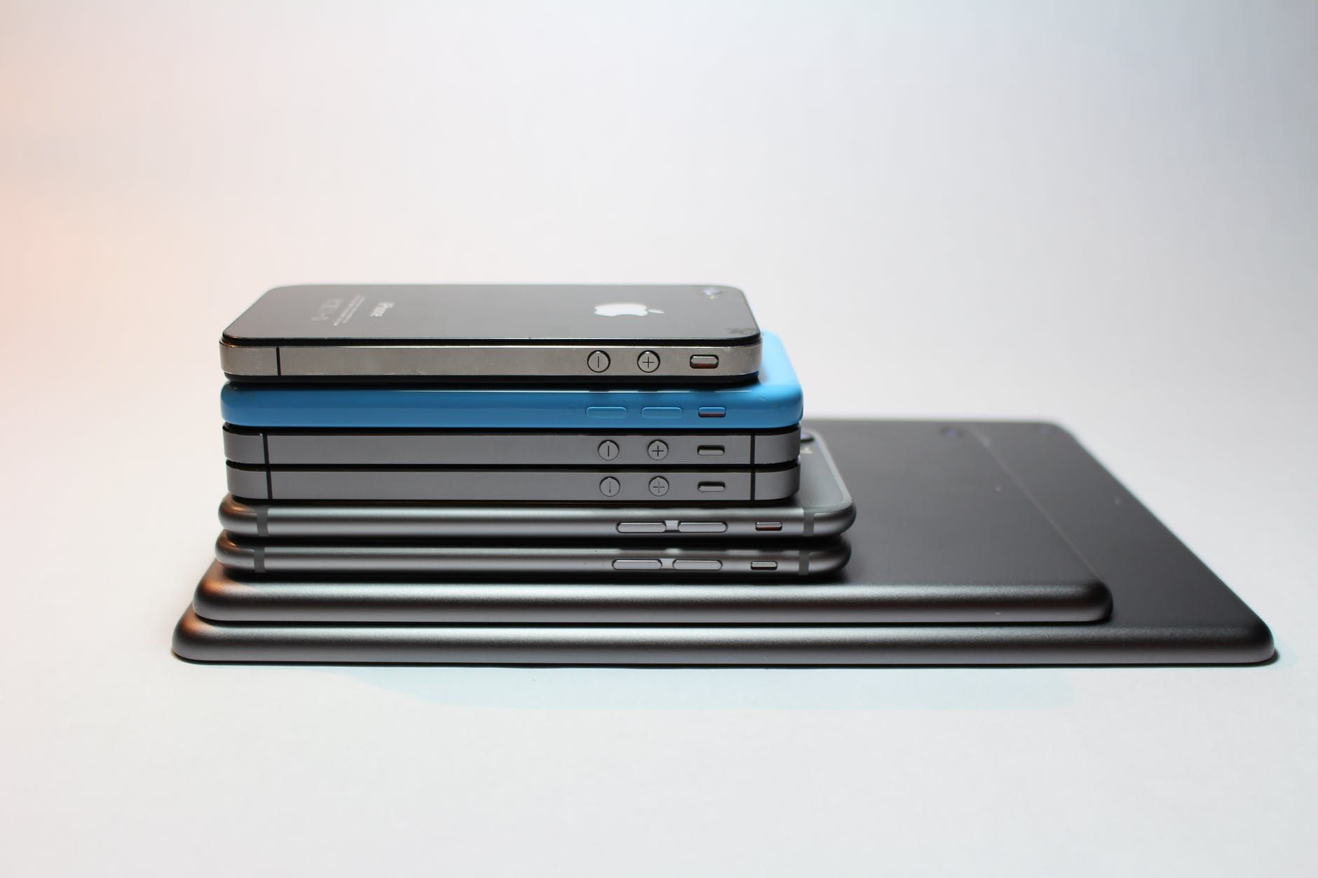 A pile of iPhones stacked up on each other