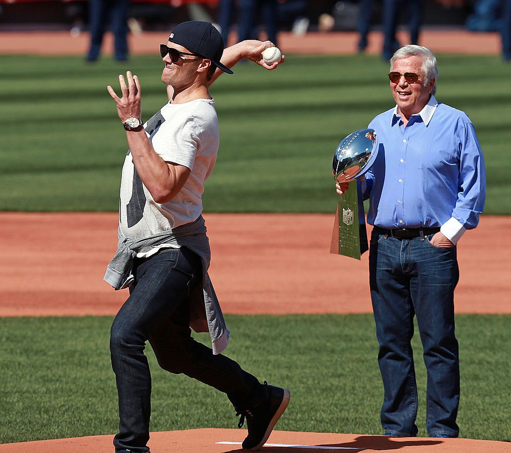 New England Patriots quarterback Tom Brady, left, throws out the ceremonial first pitch as team owner Robert Kraft, right, looks on.
