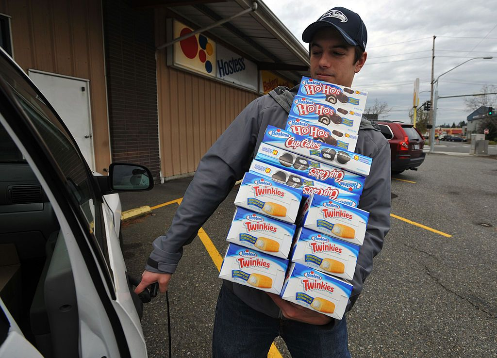 Andy Wagar loads Twinkies, Ho-Hos and cupcakes into a van outside the Wonder Bakery Thrift Shop