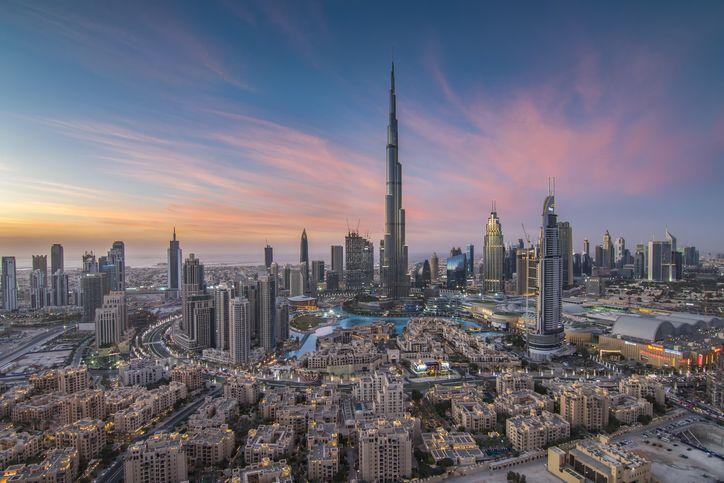 Burj Khalifa towering above dubai in the sunset
