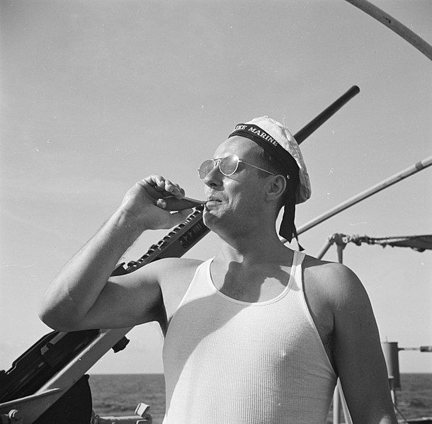 Man blowing Boatswain Pipe
