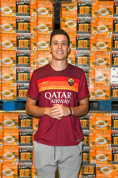 Man standing in front of ramen noodle packages