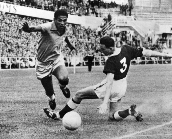 Pele dribbling past welsh defender 1958