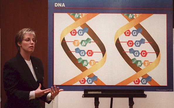 Lecuter lecturing about DNA in classroom