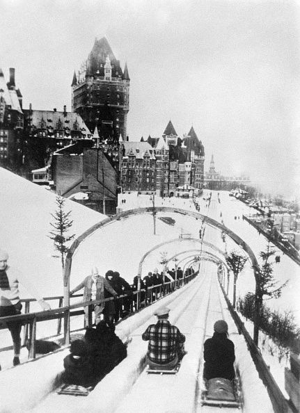 People sleighing down an ice track in 1932