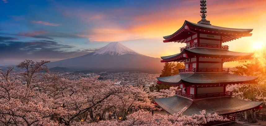Beautiful view of mountain Fuji and Chureito pagoda at sunset, japan in the spring with cherry blossoms, Fujiyoshida, Japan