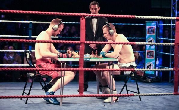 two men playing chessboxing
