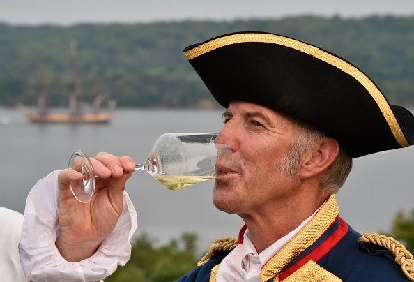 Captain Yann Cariou drinking white wine