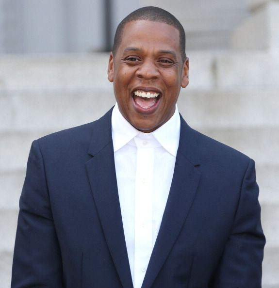 Jay z laughing in a suit