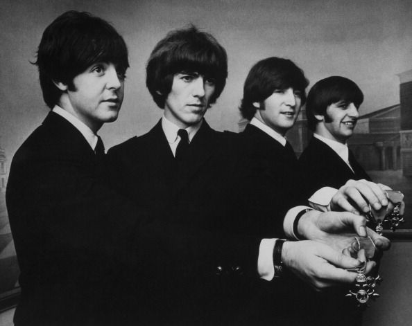 the beatles holding some jind of jewlery