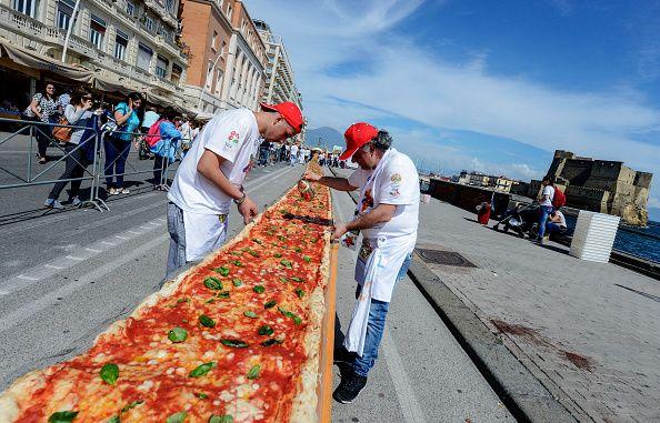 pizza chefs making hte world's longest pizza