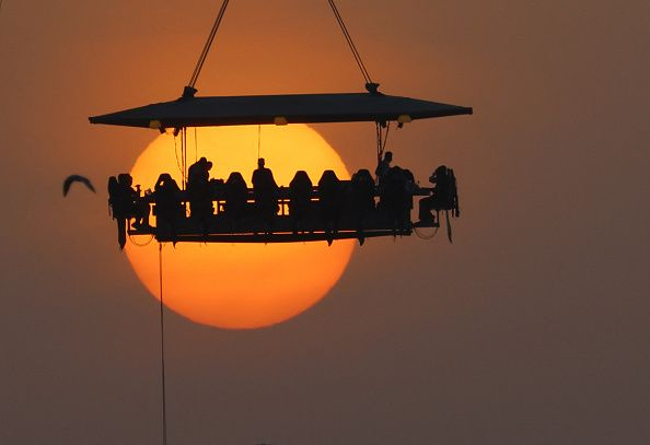 silhouettes dining in the sky