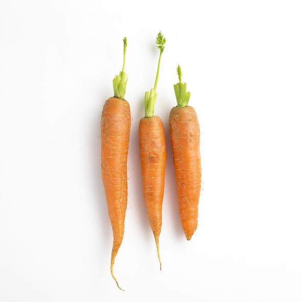 Three carrots on a white background