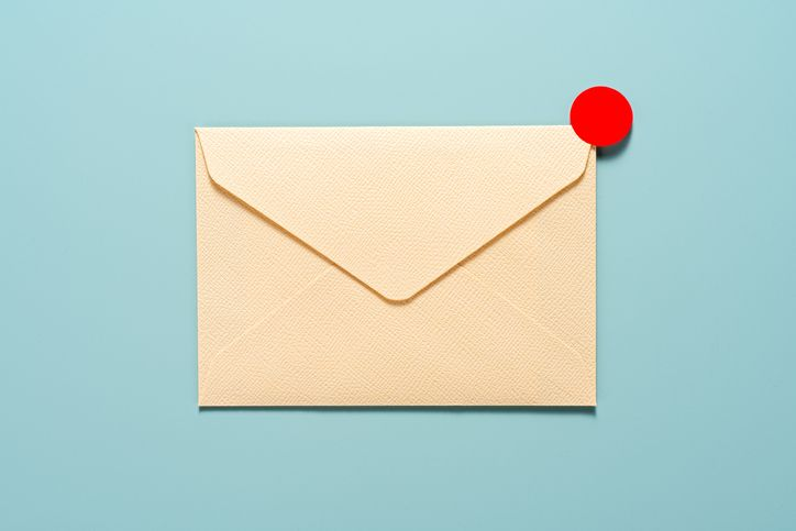 envelope with red seal on top