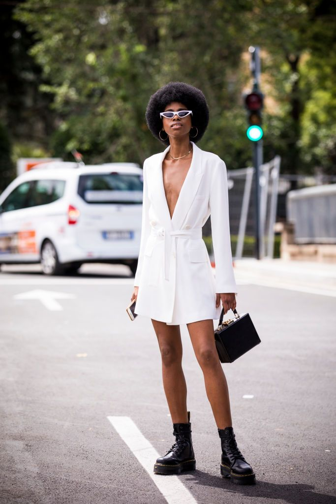 woman with an afro on the street