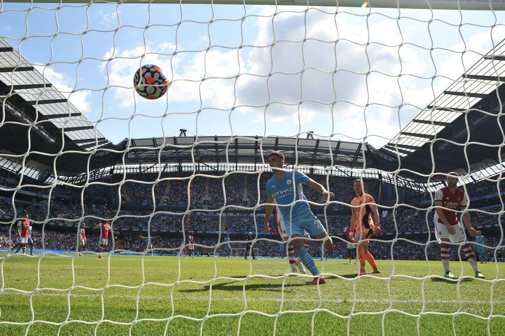 Manchester city scoring a goal against arsenal