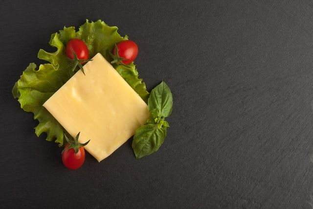 cheddar cheese on black table